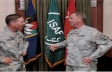 Brig. Gen. Johnson (right) with Gen. David Patraeus in 2010.         Photo provided by Duke Doering.