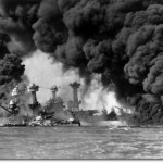 The U.S. Navy battleships USS West Virginia (BB-48) (sunken at left) and USS Tennessee (BB-43) shrouded in smoke following the Japanese air raid on Pearl Harbor.