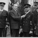 President Calvin Coolidge awarding the Medal of Honor to Warrant Officer Floyd Bennett (right) and Commander Richard E. Byrd (left) for the first flight over the North Pole on 9 May 1926.