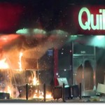 Rioters burn a store in Ferguson