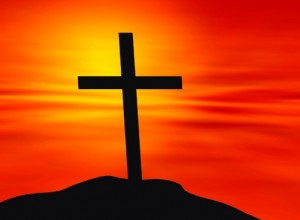 Cross against a sunset background