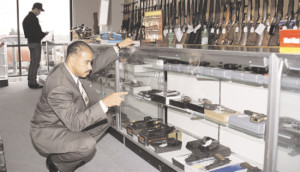 ATF inspector at a federally-licensed gun dealer. (Source: ATF)