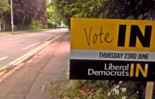 "hoto of a campaign sign photographed outside a residence in the east of England on 18 June 2016. The sign says ""Vote In"", in reference to the ""Brexit"" referendum, and is emblazoned with the word mark of the UK Liberal Democrats. (Photo credit: Lava Baron)"